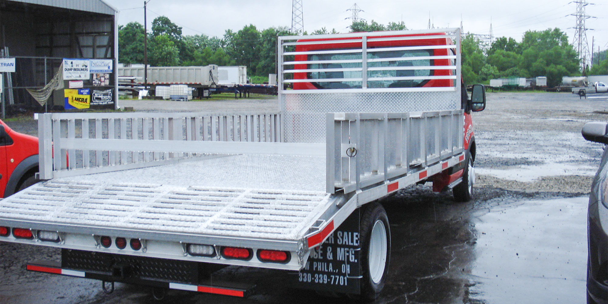 aluminum flatbed with tilt ramp